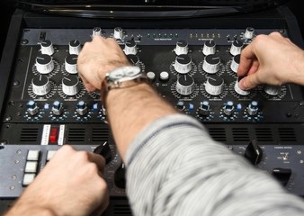 Hands on a sound mixer