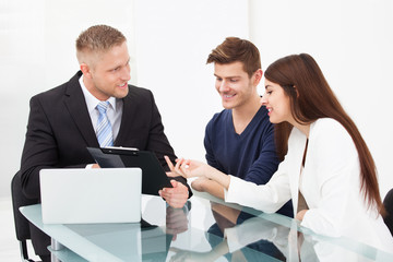 Couple Discussing With Financial Advisor