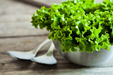 Fototapety lettuce salad in metal bowl and spoons