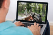 Man Playing Action Game On Laptop