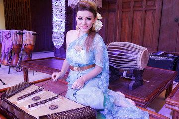European Woman Playing Thai Musical Instrument Dulcimer