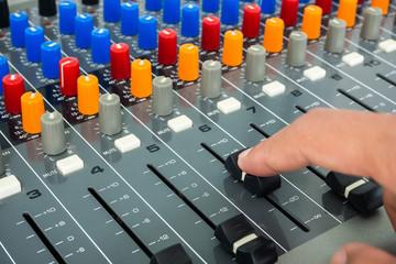 Hand on a sound mixer