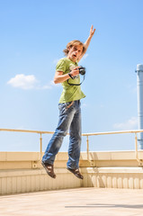 crazy cheerful photographer in jump