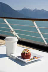 Delight With A Cupcake And Hot Drink On The Deck Of Cruise Ship
