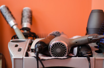 close up of hairdressing accessories in gray shelf