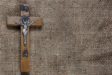 Wooden cross on old canvas