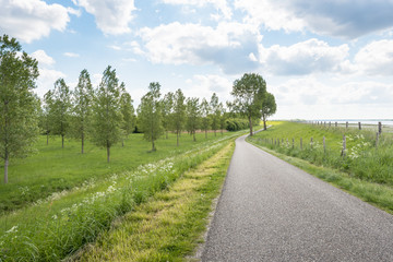 Curved country road along a Dutch dike