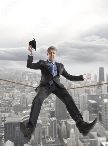 Businessman sitting on a rope