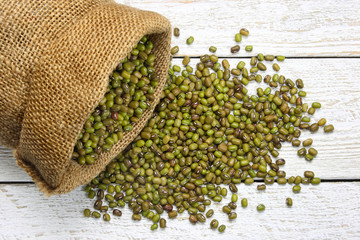 Raw mung beans in canvas sack