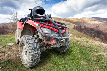 ATV on mountains landscape on a sunny day