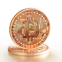 Photo .Golden Bitcoins on a white background(new virtual money )