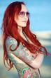 canvas print picture - rothaarige Frau stark tätowiert