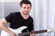 Musician with electric guitar