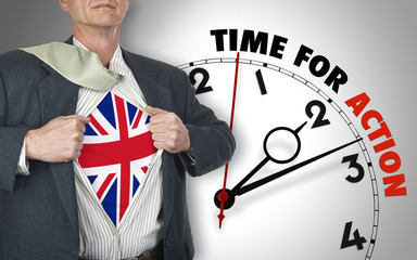 Businessman showing shirt with flag from UK suit against clock
