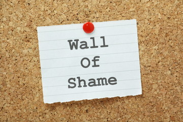 The phrase Wall of Shame on a cork notice board