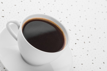 Cup of coffee on spotty background