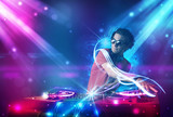Fototapety Energetic Dj mixing music with powerful light effects