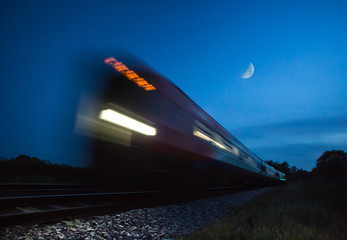 Train speeding passed in blur at night
