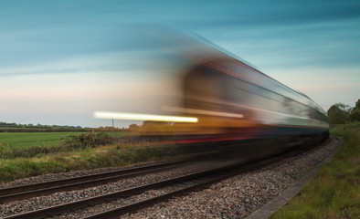 Train speeding passed in blur
