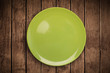 Colorful empty plate on grungy background table
