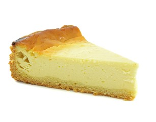 A triangle slice of plain cheese cake on a white background