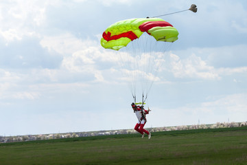 Skydiver in the sky, parachute landing