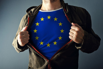 Man stretching jacket to reveal shirt with European Union flag