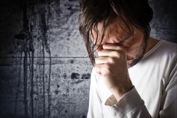 Depressive man is crying
