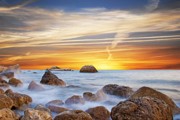 Wonderful landscape with sunset on the beach on the seashore in