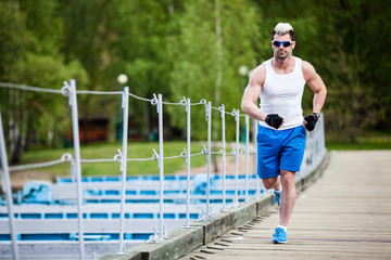 Man jogging - male running. Sporty fit young