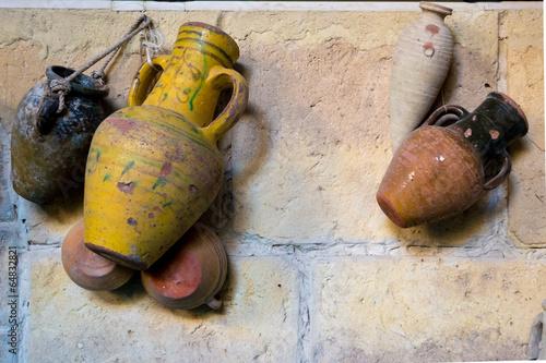 Foto op Aluminium Tunesië Different Urns on Wall
