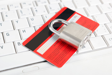 Credit Card and padlock on keyboard - security.