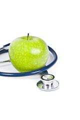 stethoscope and apple isolated on white background