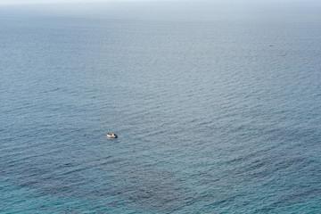 little fishing boat on huge ocean