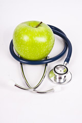 stethoscope and apple isolated on white background