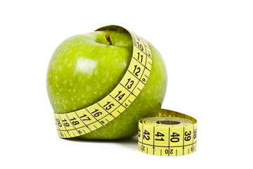 apple and measuring tape isolated on white background