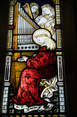Saint Cecilia, playing organ, stained glass