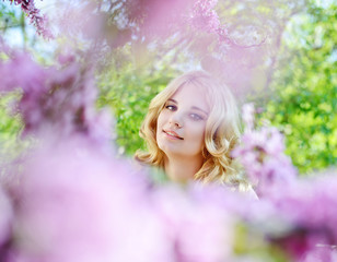 girl in spring flowers garden