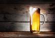 Mug of light beer with foam - 64836090