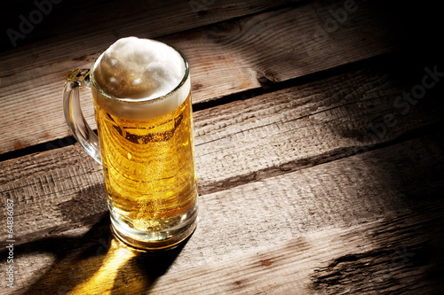 Transparent glass with light beer - 64836087