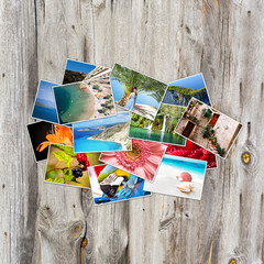 Old paper and photos on wooden background.