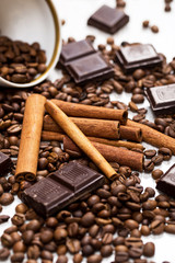 Coffee beans, cinnamon stick and chocolate