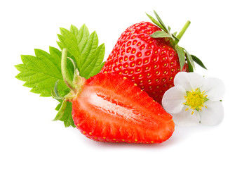 Strawberries with leaves and blossom isolated on a white