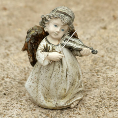 little angel figurine  playing violin