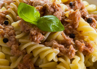 italian pasta with tuna, black peppers and tomatoes