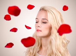Caucasian woman standing between falling petals