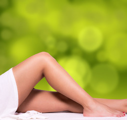 Beautiful legs with green gradient background.