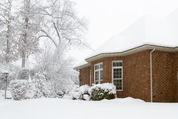 Snow Covered Brick House