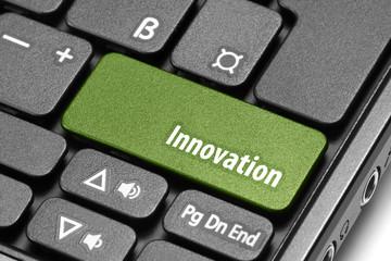 Innovation. Green hot key on computer keyboard