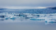 Beatiful vibrant picture of icelandic glacier and glacier lagoon - 64843451